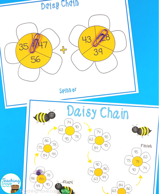 Kids love games! Grab a FREEBIE and make double digit addition with regrouping fun.