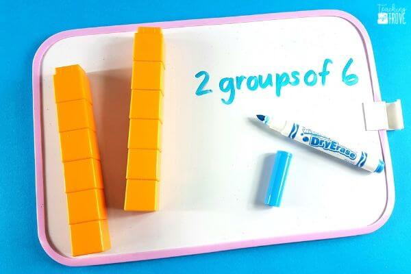 Use concrete materials to introduce multiplication